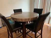 A Beautiful Dinning table with 4 leather Chairs Odenton, 21113