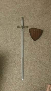Knights sword and wall plaque.