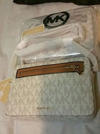 Micheal Kors Cross body , cream and caramel color