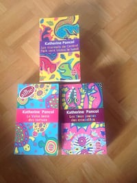 four assorted color of assorted books