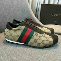 pair of beige-red-green-black Gucci low-top sneakers with box Vancouver, V6P 2X2