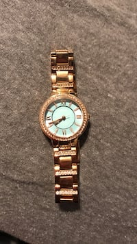 round gold-colored analog watch with link bracelet Tucson, 85719