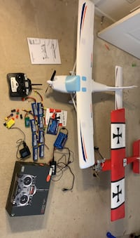 Two electric RC planes and controllers.