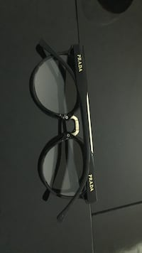 black frame Prada sunglasses