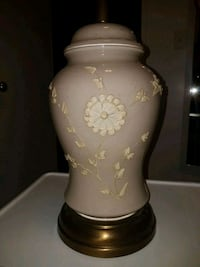 brown and white floral vase with lid