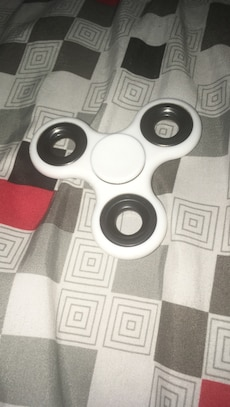 white and black 3-blade fidget spinner