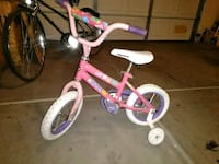 toddler's pink and white bicycle with training wheels Peoria, 85381