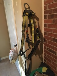 green and black safety harness