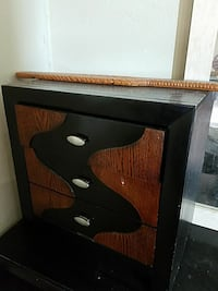 black and brown wooden 3-drawer chest