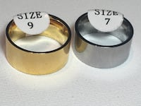 NEW - Sweet Looking 10mm Wide Solid Band. Stainless Steel. Two Colors Two Sizes - $ 25 Each Edmonton