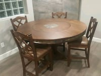 round brown wooden table with four chairs dining s Tucson, 85716