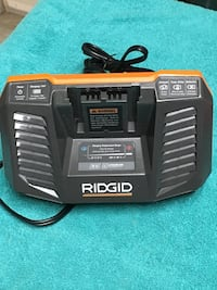 black and orange Ridgid battery charger Calgary, T2Y 3L2