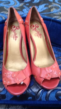 women's pair of orange leather flats Calgary, T1Y 3A9