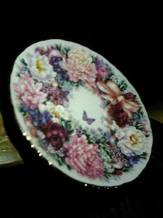 white, pink, green, and brown floral ceramic plate