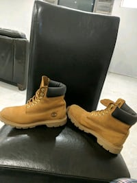 pair of brown Timberland work boots Hamilton, L0R 1W0