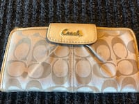 brown monogrammed Coach leather wristlet Vacaville, 95688
