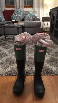 Pair of black and-green hunter rain boots