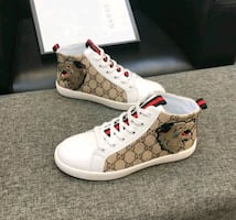 men's Gucci high-top monogram with wolf logo