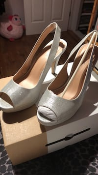 pair of gray peep-toe platform stilettos Toronto, M6N