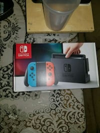 white and red Nintendo Switch with box Toronto, M3C 1A1