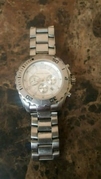 round silver-colored chronograph watch with link b Oceanside, 92054