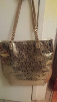Gold MK leather tote bag