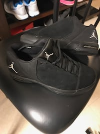 Black air jordan basketball shoe..