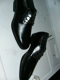 pair of black leather dress shoes Junction City, 66441