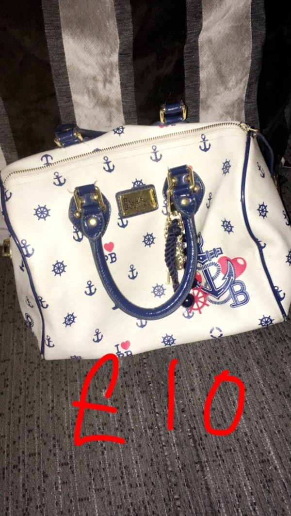 white and blue floral leather handbag