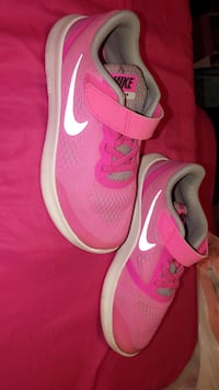 Pair of pink nike running shoes size 2  Lubbock, 79403