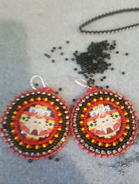 pair of red-black-yellow-and-silver-colored dangle hook earrings