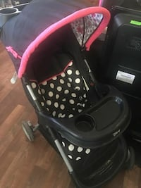 black, white and pink polka-dot print stroller