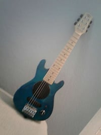 blue and beige youth size electric guitar
