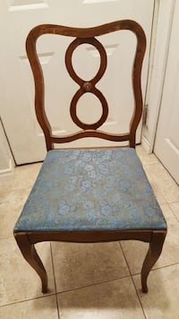 brown wooden framed blue and white floral padded chair