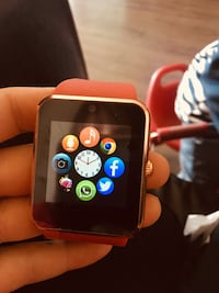 black smartwatch with yellow strap Edmonton, T5Y