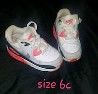 pair of white-and-pink Nike running shoes Columbus