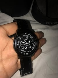 Round black chronograph watch with black strap Lawrenceville, 30046