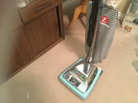chrome and blue upright vacuum cleaner Central Okanagan, V4T 2Y5