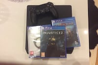 black Sony PS4 Slim with controller and box