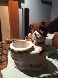 white, red, and green snowman with bowl ceramic figurine