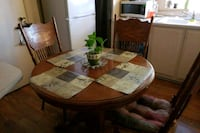 round brown wooden table with four chairs dining s Ontario, 91761