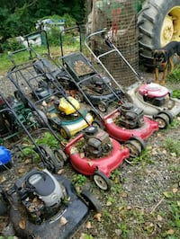 two red and one black push mowers Caledon, L7C 2P7