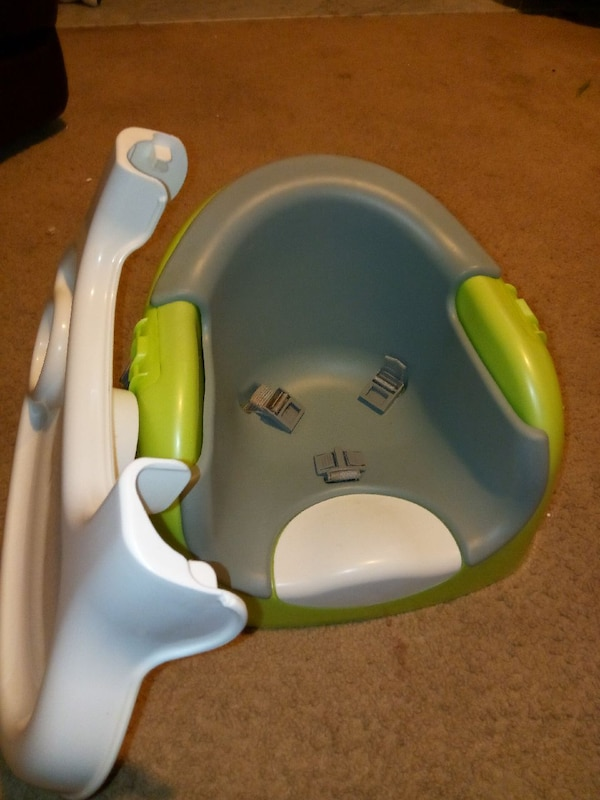 Baby's blue and green floor seat
