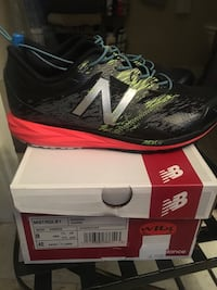 gray-and-black New Balance low-top sneakers with box