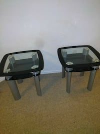 two square gray and black glass top side tables
