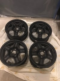 GM Black rims (good price) Laval, H7T 2Z9