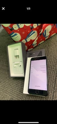 space gray iPhone 8 Plus with box, USB power adapter, and EarPods with Lighting connector screenshot 656 mi