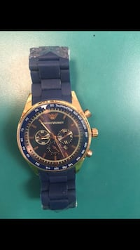 round gold-colored chronograph watch with black link bracelet 272 mi