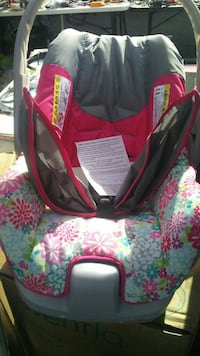 baby's gray, pink, and green floral car seat carrier