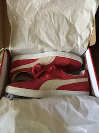 Red puma low-top sneakers